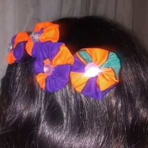 Decorative hair combs and bows.